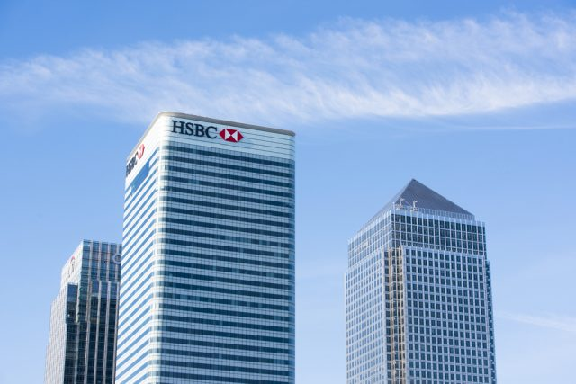 HSBC first-half profits hampered by expenses and settlement