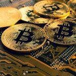 Golden,Coins,With,Bitcoin,Symbol,On,A,Mainboard.